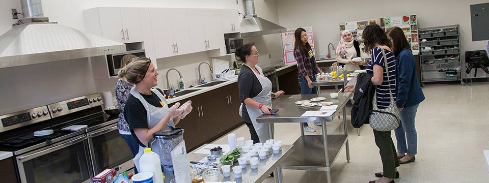 Nutritional Sciences students presenting a healthy food demonstration.