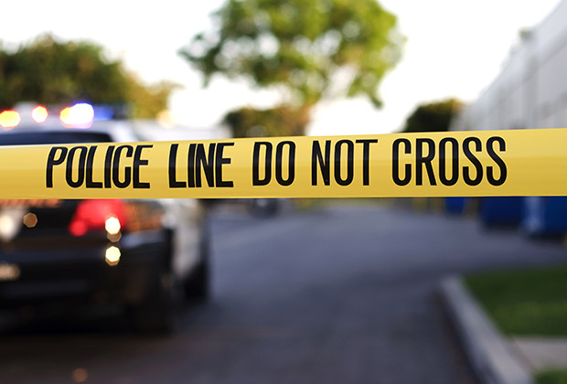 Police tape at a scene of an investigation.