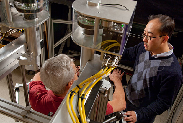 Jinsung Wang, Assistant Professor of Kinesiology, with a research subject in the Motor Control Laboratory.