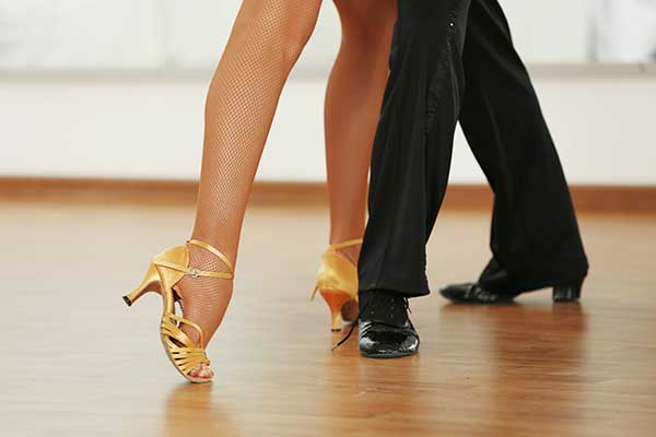 Woman and man legs in active ballroom dance.