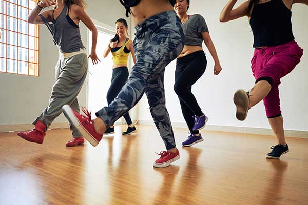 Group of women in cardio hip hop class.