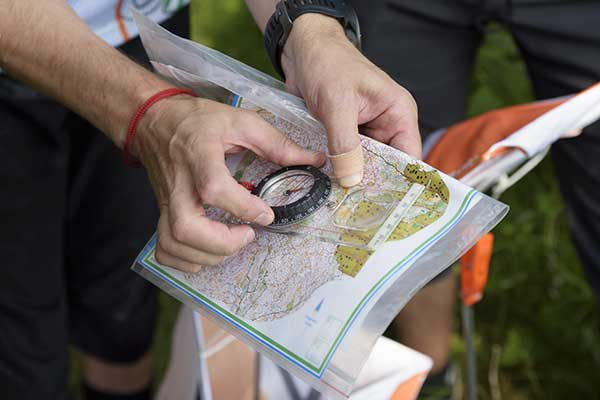 Compass and map for orienteering.