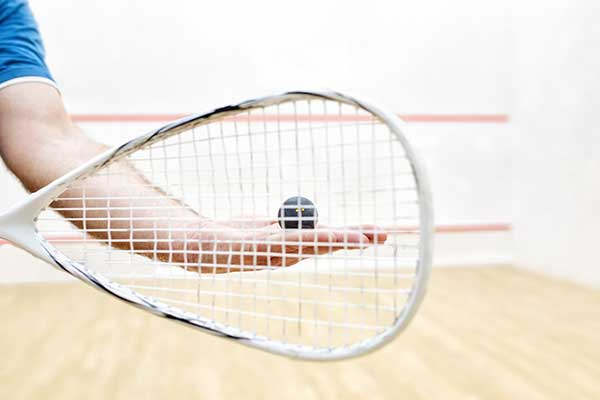 Man's hand ready to serve racquetball.