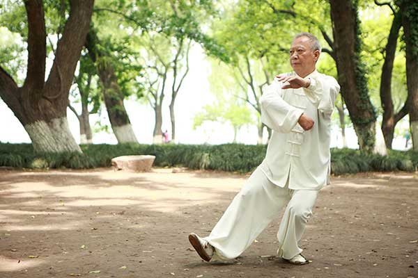 Senior gentleman practicing tai chi.