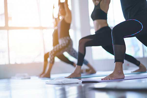 Women exercising in fitness studio yoga classes.