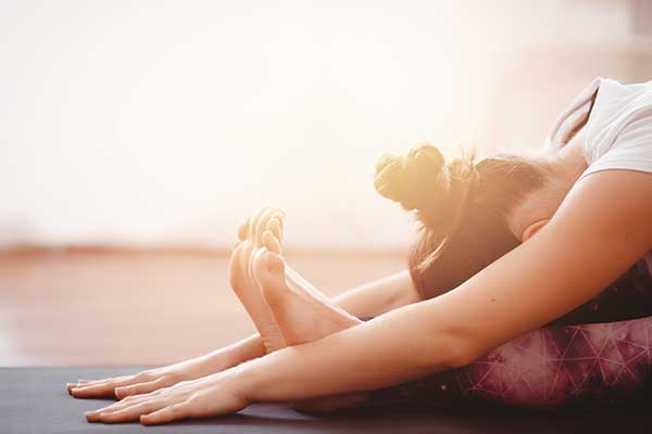 Woman meditates while practicing yoga