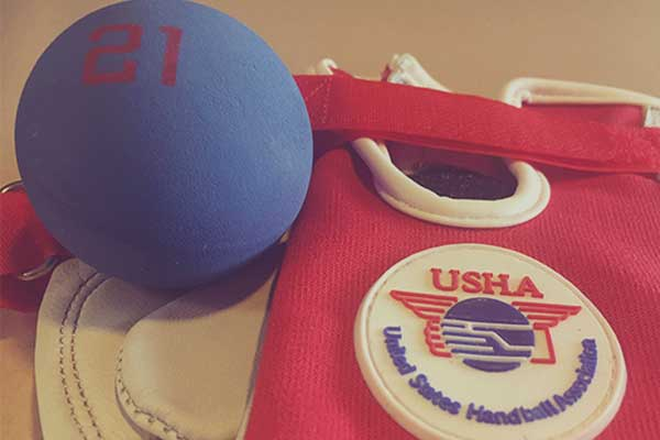 Close up of handball with a United States Handball Association glove.