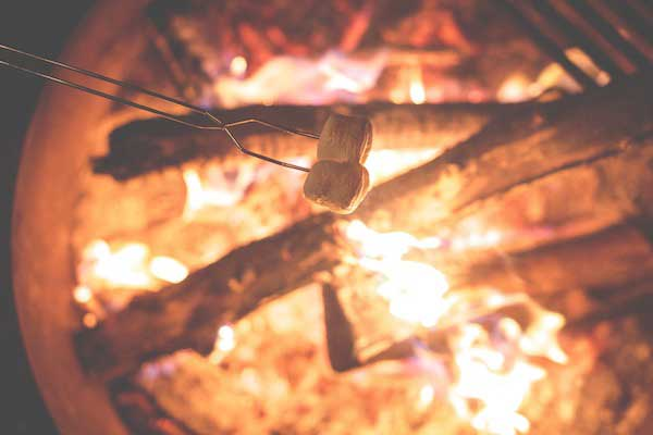 Close up of marshmallows being roasted over a campfire.