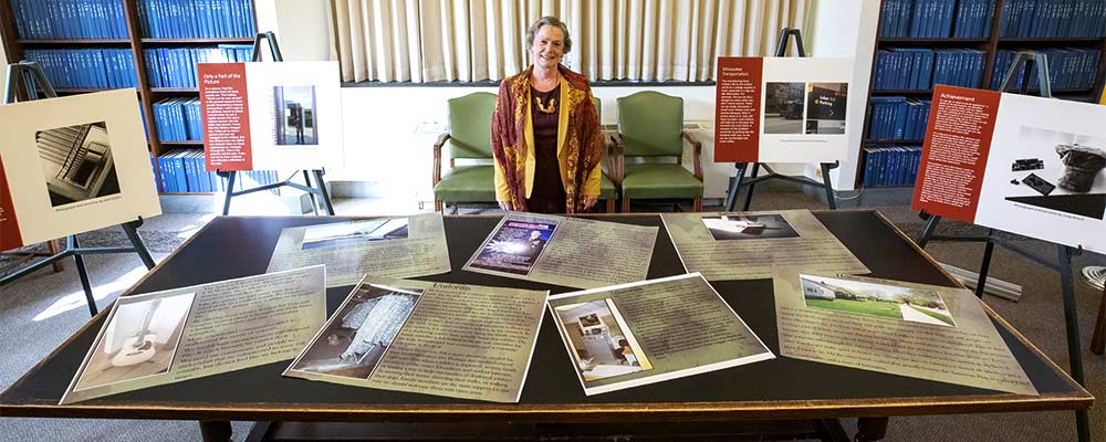 Virginia Stoffel with posters of her photovoice research.
