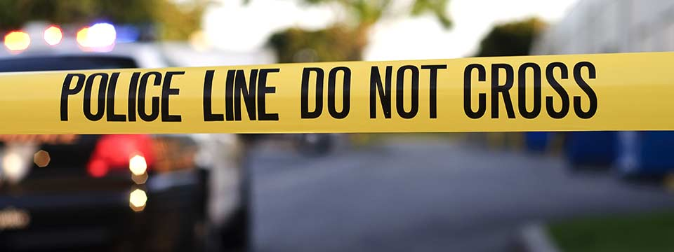 Police tape at a scene of an investigation