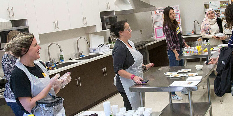 Students in nutritional science course working in a kitchen