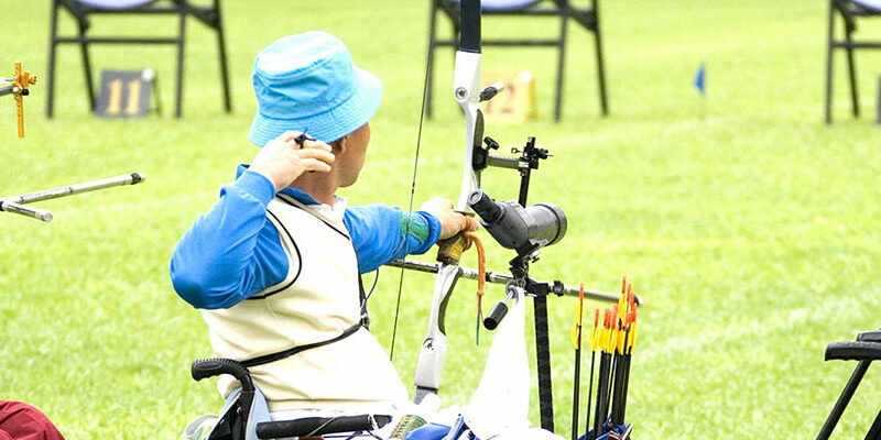 Three archers shooting from a wheelchair for therapeutic recreation
