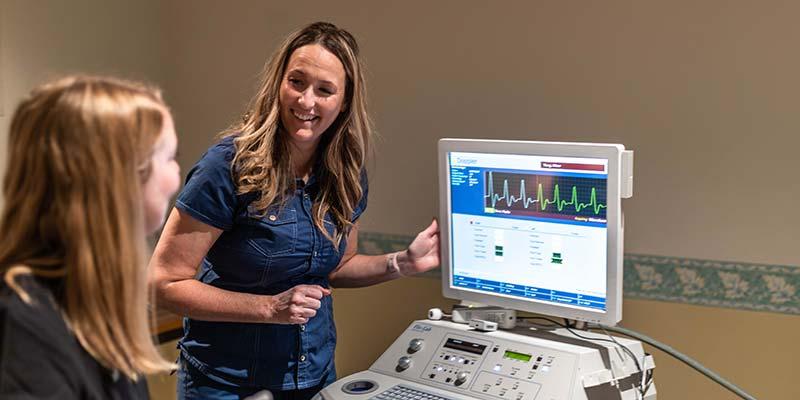 Student performing a diagnostic imaging procedure