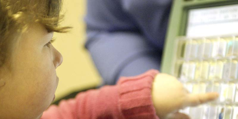 Child learning alternative communication techniques