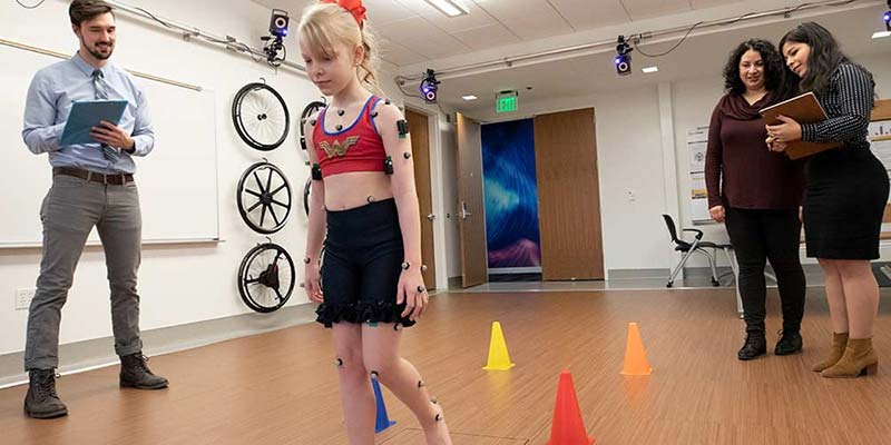 Young girl being tested using mobility technology