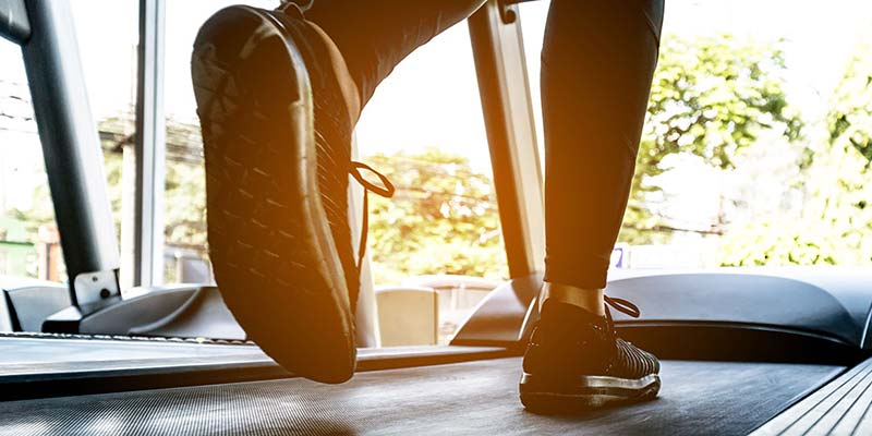 Close up of person's feet while walking on a treadmill
