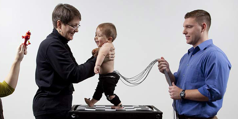 Baby being tested by researchers in the Pediatric Neuromotor Lab