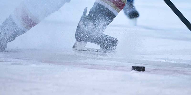 Close up of person's feet who is playing hockey