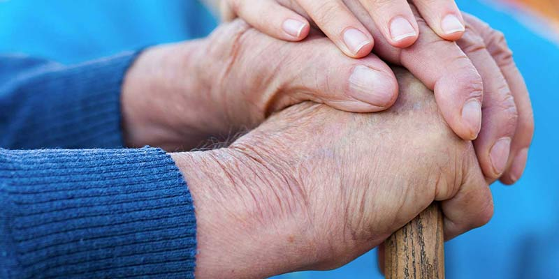Close up of two older people's hands.