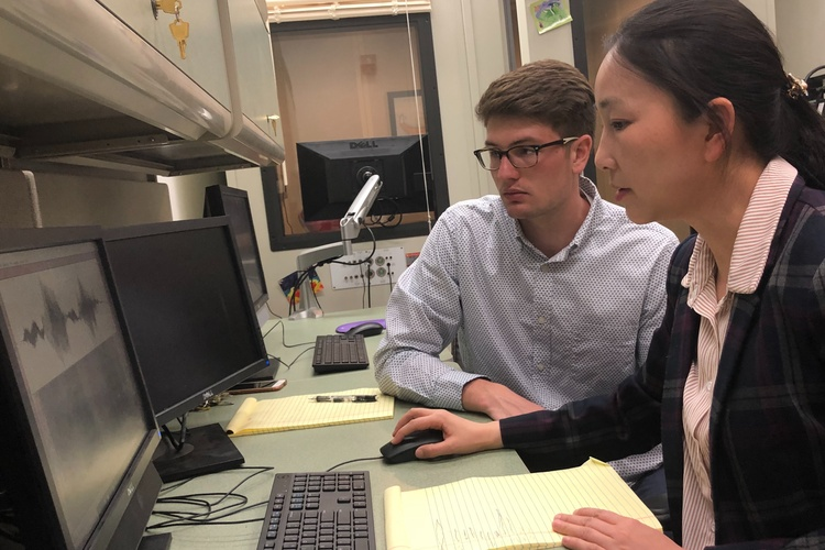 Professor Jing Yang works with a student in the Speech Acoustics & Development Laboratory. They seek to improve the speech intelligibility of L2 (a person's second language) learners and speakers who struggle with speech-language-hearing impairments.
