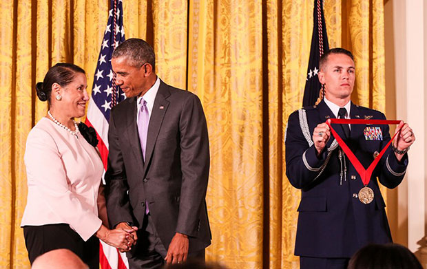 Evelyn Brooks Higgenbotham shaking hands with Barack Obama