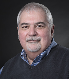 Studio portrait of School of Information Studies faculty member Richard Smiraglia.
