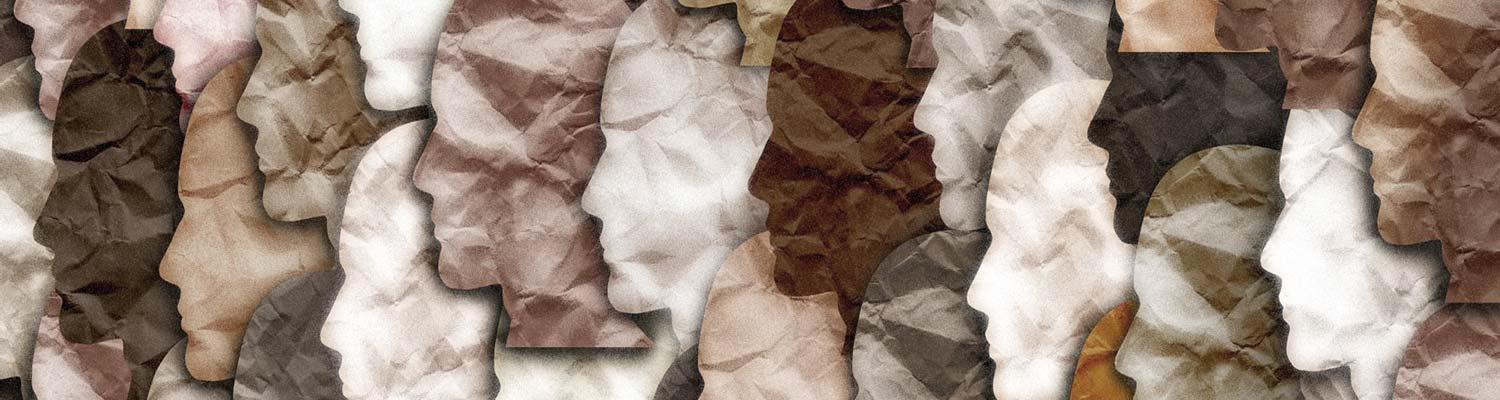 Silouettes of people cut out in paper and collaged together with various skintones represented