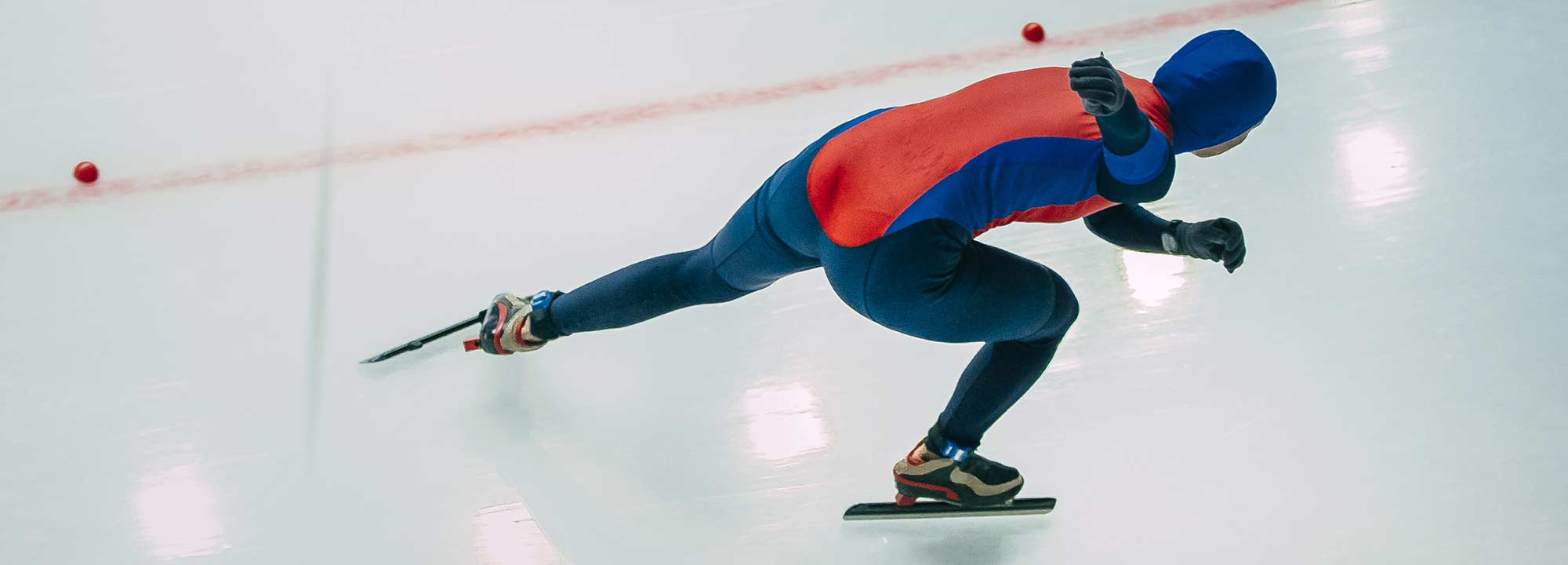 Long track speed skater from above