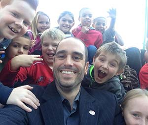 Alumnus Dan Devine ('95, BA Political Science) takes a selfie with students from Irving Elementary School during their November field trip to the West Allis City Hall. Meeting with constituents - no matter their size - is part of Devine's duties as mayor.