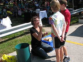 Waukesha County Solid Waste Supervisor Rebecca Mattano educates children about the importance of recycling. Photo courtesy of Rebecca Mattano.