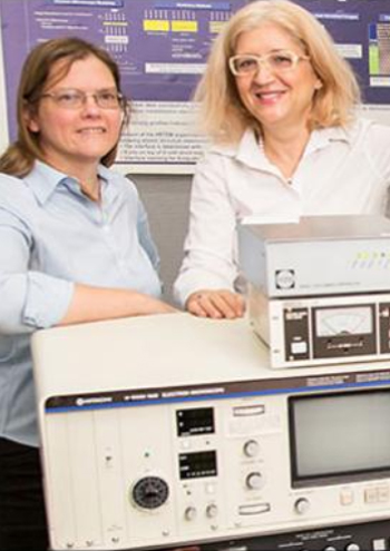 Carol Hirschmugel and Marija Gardardziska standing with lab equipment