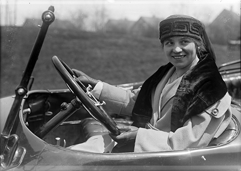 Woman driving car from the Milwaukee Polonia Digital Collection