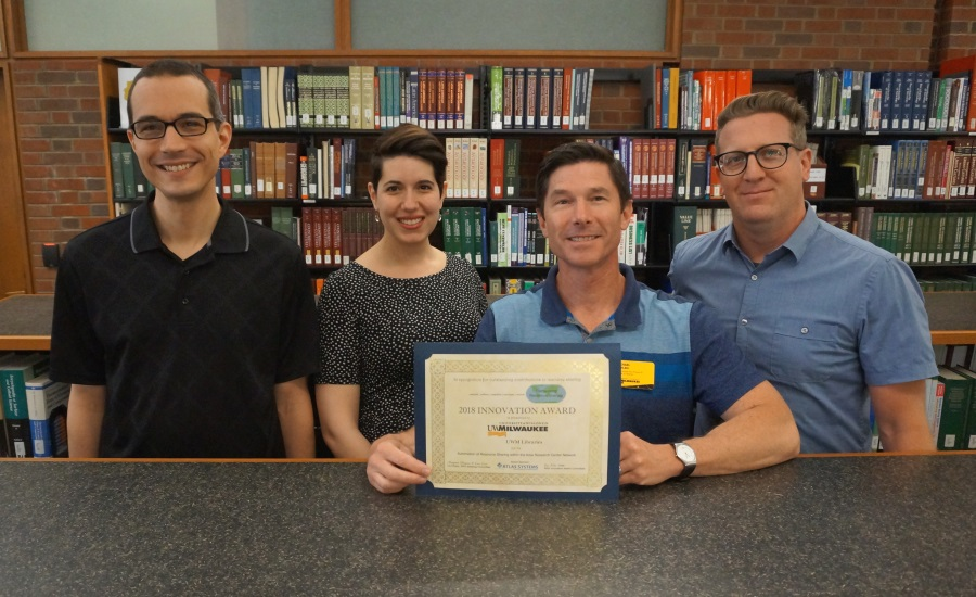 photo of UWM Libraries staff who worked on the award-winning project: from left, Joe Tomich, Abigail Nye, Michael Doylen, and Aaron Dobbs.