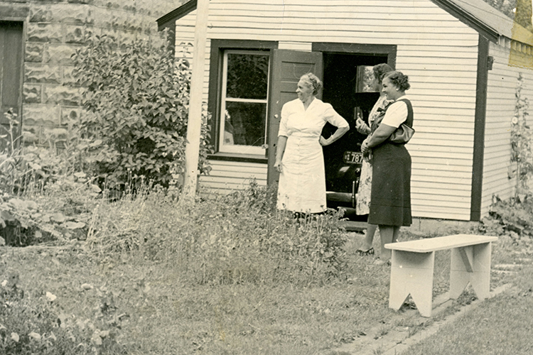 This picture, part of the Lands We Share exhibit, shows the garden in the backyard of a family home in the Bronzeville neighborhood of Milwaukee during the 1940s. (Photo courtesy of the Wisconsin Black Historical Society/Museum)
