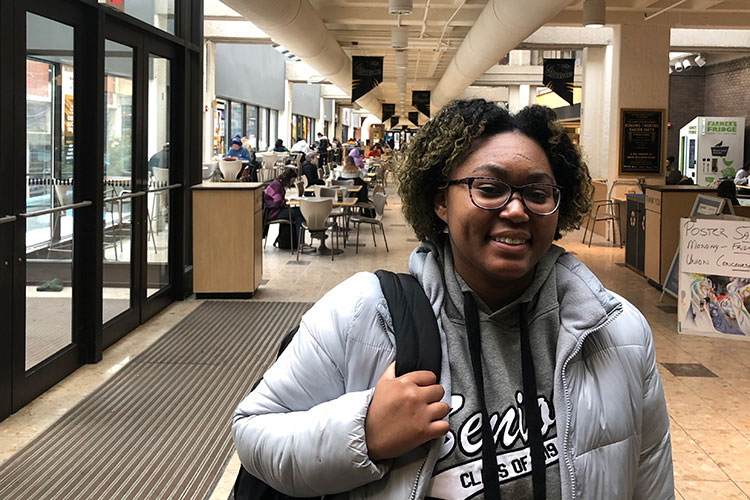 A college student poses for a picture at the student union