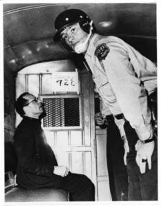 James Groppi in back of police wagon. Courtesy Wisconsin Historical Society