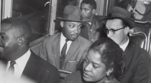 Martin Luther King, Jr. during bus ride, Montgomery, Alabama