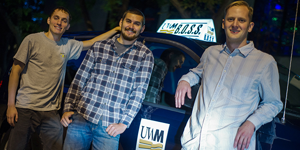 Bryan Weber, at right, with drivers James Weglarz, a mechanical engineering major (left) and John Klein, a criminal justice major. (Photos by Kenny Yoo)