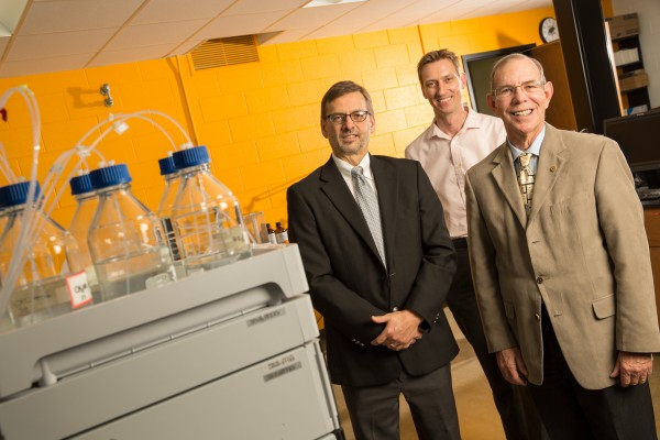 The research team investigating a new treatment for asthma are Douglas Stafford (from left), director of the Milwaukee Institute for Drug Discovery; Alexander Arnold, assistant professor; and Distinguished Professor James Cook. They are using equipment at the new Southeastern Wisconsin Applied Chemistry Center for Excellence. (Photo by Troye Fox)