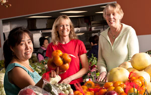 Westlawn project leaders Anne Dressel (center) and Betty Koepsel (right) of UWM's College of Nursing with Pai Yang (left) at the Milwaukee Asian Market. Yang is the owner of the market, which is a business partner in the Westlawn project.  Access to fresh produce is  a concern of Westlawn residents.  Photo by Troye Fox
