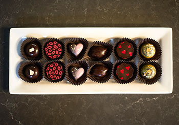"Here's a look at Indulgence Chocolatiers' Valentine's Day collection, with citrus basil, rose water pistachio, Banana's Foster, balsamic fig, smoky pomegranate and ginger, passion fruit, caramel truffles."" (Photo by Kenny Yoo)"
