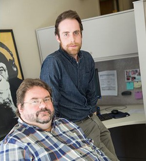 Shawn Cahill (seated) with grad student Geier. (UWM photo by Troye Fox)