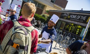 Brewers pitcher Jim Jeffress serves food Wednesday during a surprise tailgate party for students in Spaights Plaza. (UWM Photo/Derek Rickert)