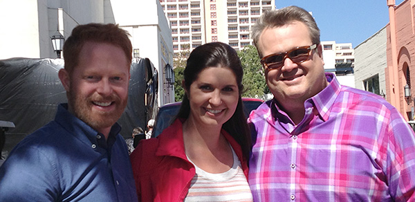 Brittani Ebert with stars Jesse Tyler Ferguson (left) and Eric Stonestreet, on the set of Modern Family.