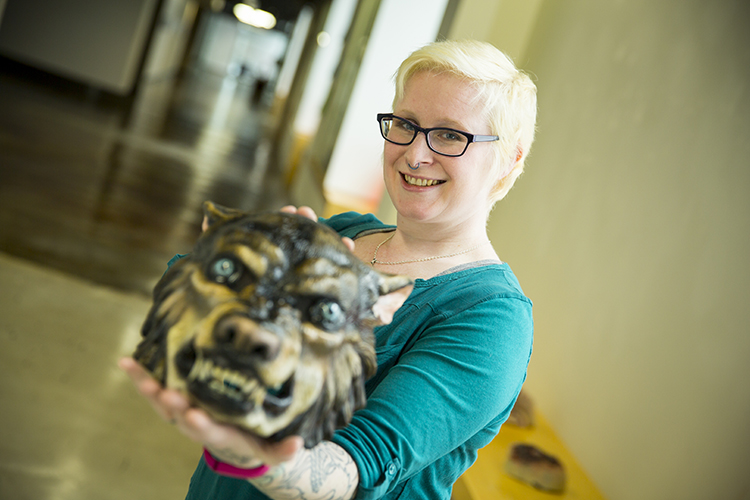"Alumna Melissa Ebbe (standing) makes masks and role-playing accessories as owner and artist at Milwaukee-based company Feral Works. Jan. 13, she takes her talents to TV as a cast member of the SyFy reality series ""Face Off."" (UWM Photo/Derek Rickert)"