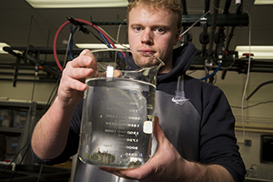 Graduate student Stephen Binter is enrolled in the Urban Aquaculture Certificate Program at the School of Freshwater Sciences. He believes raising fish holds great potential in Milwaukee. (UWM Photo/Derek Rickert)