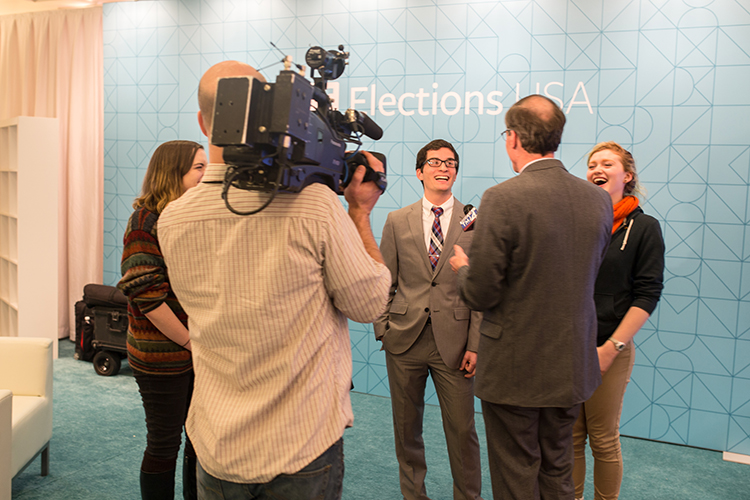 UWM students Katy DeZellar, Jack FitzGerald, and Sarah Benforado who viewed the Democratic Debate live in the Helene Zelazo Center speak about the experience with Newscasters. (UWM Photo/Elora Hennessey)