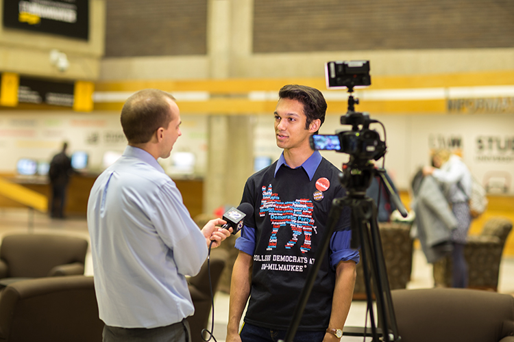 Evan Braun, vice-president of the Student Association, speaks to a reporter about the primary debate. (UWM Photo/Elora Hennessey)