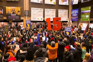 Protestors calling for an increase in the minimum wage chant and bang drums in the Union concourse. (UWM Photo/Elora Hennessey)