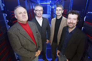 Alan Wiseman (from left), Patrick Brady, Jolien Creighton and Xavier Siemens lead UWM's LIGO team. (UWM Photo/Pete Amland)
